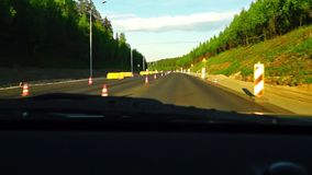 Car moves along the repairing road stock video footage