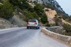 Car Moves along a winding road in the mountains during royalty free stock images