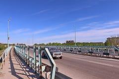 Car moves on bridge of asphalt road Royalty Free Stock Image