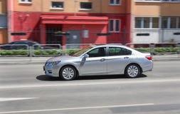 Car moves on city street Royalty Free Stock Photo