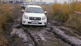 Car moves on dirty rally track stock footage