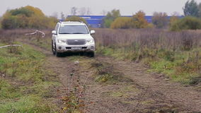 Car moves on dirty rally track stock video
