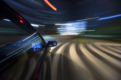 The car moves at great speed at the night. Stock Photos