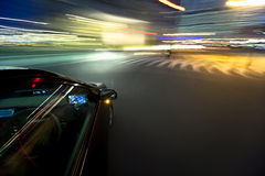The car moves at great speed at the night. Stock Images