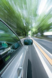 The car moves at great speed at the sunny day. Royalty Free Stock Images