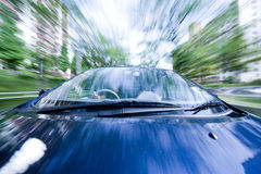 The car moves at great speed at the sunny day. Stock Photo