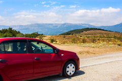 Car moves on mountainous highway Stock Image