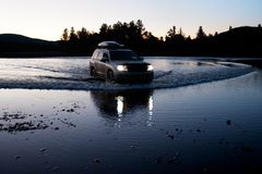Car moves to fording the river in Mongolia Royalty Free Stock Images