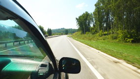Car is moving along the trees in Altay (POV). POV: Car is moving along the trees on a highway in Altay, Russia stock video
