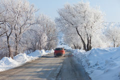 Car moving on beautiful winter road Stock Photos
