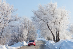 Car moving on beautiful winter road Royalty Free Stock Photos