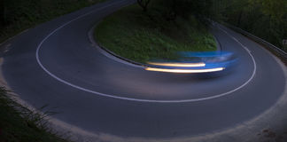 Car moving on the curve of the road Royalty Free Stock Photos
