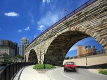 Car moving in downtown Minneapolis and  Stone Arch Royalty Free Stock Image