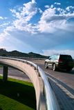 Car moving on the elevated road. Under blue sky royalty free stock images