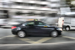 Car moving fast across the street Stock Photography