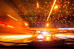 Car moving fast night light blur raining drive. R view from console dashboard royalty free stock photos