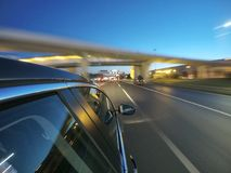 The car is moving at high speed on the night road in the city. Royalty Free Stock Image