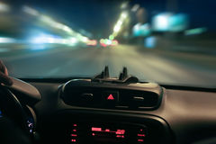 car moving on highway at night Stock Photography