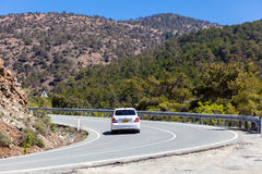 Car is moving on the mountain road Royalty Free Stock Photography