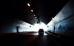 Car moving out from road tunnel Stock Image