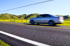Motion blur car on a rural road Royalty Free Stock Photo