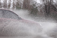 Car moving at rain weather Royalty Free Stock Image