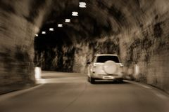 The car is moving rapidly through the tunnel. unsharply blurred.  stock image