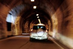 The car is moving rapidly through the tunnel. unsharply blurred.  royalty free stock images