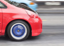 Car moving in street at rush hour. Compact car moving in street at rush hour royalty free stock image
