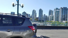 Car moving Vancouver BC summer sunny day. Tracking shot modern  highrise buildings stock footage
