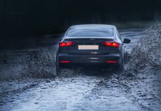 Car is moving on a wet road. In the rain Royalty Free Stock Image