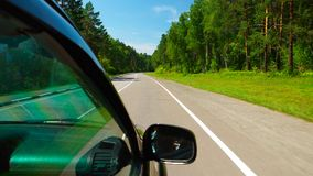 Car is moving in the Wood on a road Royalty Free Stock Photography