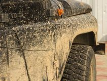 A car in the mud, after a trip off-road, close-up royalty free stock photos