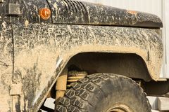A car in the mud, after a trip off-road, close-up stock photography