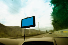 Car navigation system (empty screen). This photograph represents an GPS navigation system with empty screen on a car front window. Useful file for your travel stock image