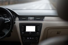 Car navigation system in modern car interior with mock up.  display of multimedia. Car navigation system in modern car interior with mock up.  display of Royalty Free Stock Photography