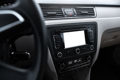 Car navigation system in modern car interior with mock up. Isolated display of multimedia. Car navigation system in modern car interior with mock up. Isolated Stock Image