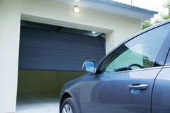Car near the automatic garage door. Automatic and convenient   garage doors opening for a car Royalty Free Stock Images