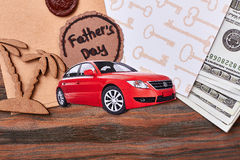 Car near money and card. Envelope with wax seal. Valuable presents for luxury life Stock Photos