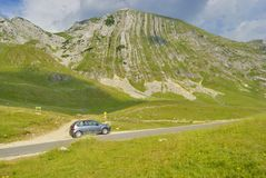 Car near Prutash mountain, Montenegro. Grey car near Prutash mountain in Durmitor national park, Montenegro Royalty Free Stock Photography