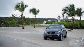 Car near tropical beach stock footage
