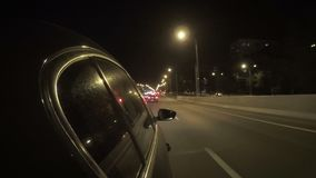 The car in the night city traffic. Car in the night city traffic on a free wide road stock video footage