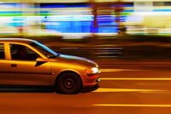 Car in night city traffic Stock Photos