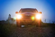 Car at night, lights on Stock Image