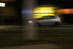 Car at night long exposure colorful. Car speeding at the night with blurred motion long exposure colorful sight background citylights Royalty Free Stock Images