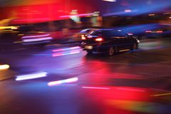 Car at nigt. Car driving on night street. Long exposure, blurred motion Stock Photography