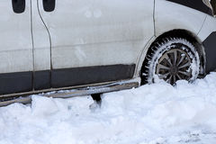 Car is not cleaned the road of snow in winter. royalty free stock images