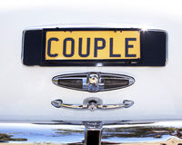 Car Number Plate - Couple. Number Plate - Couple - On Luxury White Wedding Car stock photography