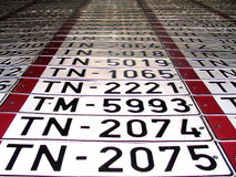 Car numbers. Wall of a garage decorated by old car numbers stock images