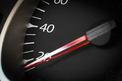 Car odometer closeup. Car odometer with a red arrow closeup Royalty Free Stock Images